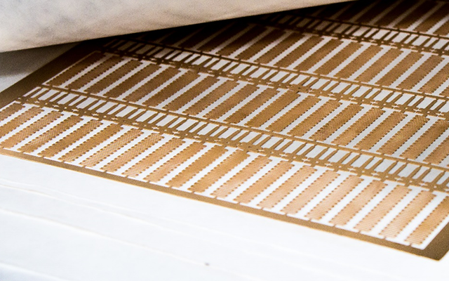 A sheet of super thin beryllium copper photo etched by United Western Enterprises, Inc.