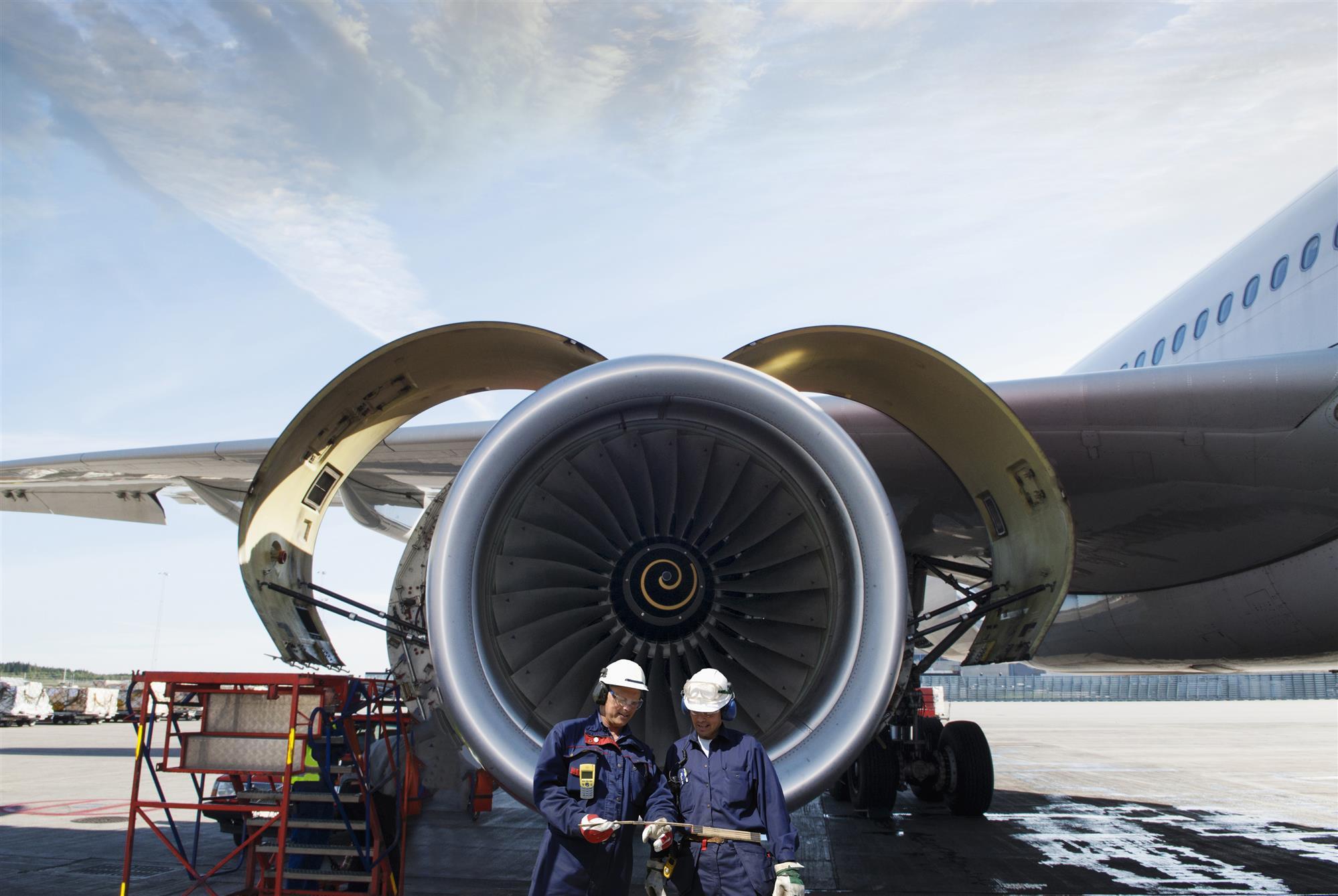 engineers working on jet engine