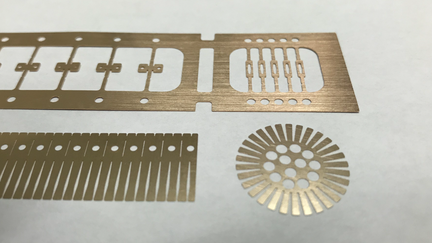 A picture showing parts produced by photo etching.