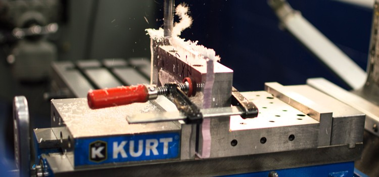 CNC machine drilling the hole at the steel shaft